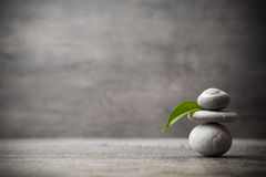 Massage stones put in the form of a pyramid. Stock Photos