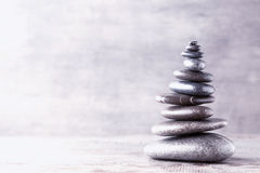 Massage stones put in the form of a pyramid. Royalty Free Stock Photo