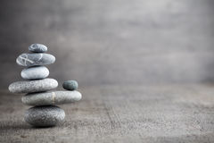 Massage stones put in the form of a pyramid. Stock Image