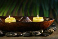 Massage stones and spa candles. For wellness concept royalty free stock photography