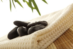 Massage stones on towel Royalty Free Stock Image