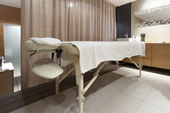 Massage table in beauty saloon Stock Photography