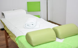 Massage table. Massage bed in spa and massage saloon Stock Image