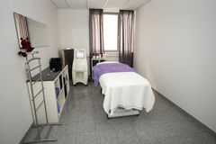 Massage table and equipment in modern beauty salon. Royalty Free Stock Photos