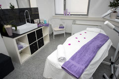 Massage table and equipment in modern beauty salon. Royalty Free Stock Images