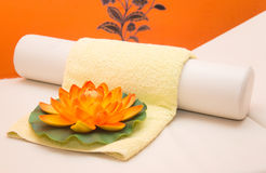Massage table, massage pillow, yellow towel and lotus flower Stock Images