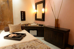 Massage table and sink in spa. Massage table and sink in luxury spa treatment room stock photography