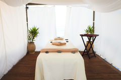 Massage table in the spa on the beach Stock Image