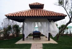 Massage table under an awning on the beach Royalty Free Stock Image