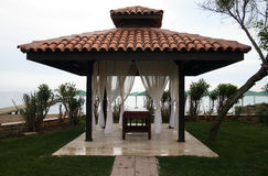 Massage table under an awning on the beach Stock Image