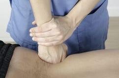 Massage technic on deep muscle lumbar. Physiotherapist doing a massage technic on deep muscle lumbar Stock Image