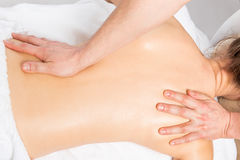 Massage technique stretching back women. In the salon Stock Photography