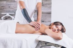 Massage for tensed back and neck. royalty free stock images