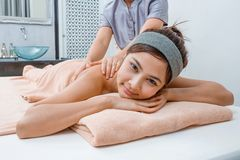 Massage in Thai spa. Aromatherapy oil massage in Thai spa royalty free stock image