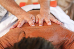 Massage therapist in action Royalty Free Stock Photos
