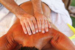 Massage therapist in action Royalty Free Stock Photo