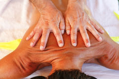 Massage therapist in action Stock Photography