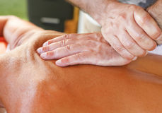 Massage therapist in action Stock Images