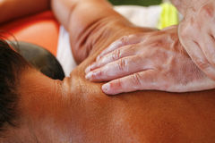 Massage therapist in action Royalty Free Stock Photography