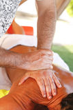 Massage therapist in action Royalty Free Stock Image