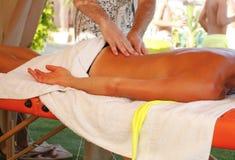 Massage therapist in action Stock Photo