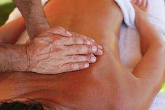 Massage therapist in action Royalty Free Stock Images