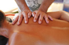 Massage therapist in action Stock Image