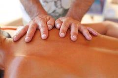 Massage therapist in action Stock Photos