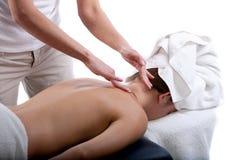 Massage therapist doing back massage stock image