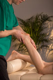Massage therapist doing functional massage Stock Photography