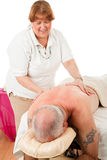Massage Therapist Enjoys Work Royalty Free Stock Images