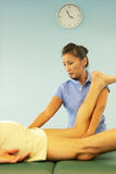 Massage therapist giving a massage Royalty Free Stock Images