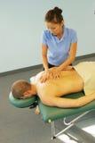 Massage therapist giving massage Royalty Free Stock Photography