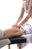 Massage therapist giving a massage Royalty Free Stock Photography