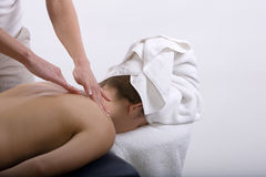 Massage therapist giving a massage Stock Image