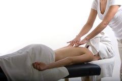 Massage therapist giving a massage Royalty Free Stock Image