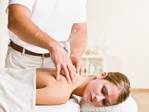 Massage therapist giving woman massage Royalty Free Stock Image