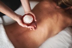 Massage therapist hold bowl with mineral salt stock photos