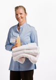 Massage therapist holding oil and towels Stock Photo