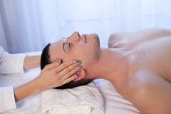 A massage therapist makes man medical back massage and body treatments at the Spa. A massage therapist makes men medical back massage and body treatments royalty free stock photos