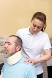 Massage. A therapist massages the neck of an injured man Stock Photos