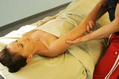 Massage therapist massaging arm Stock Photography