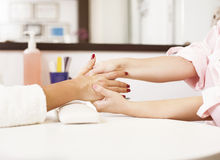 Massage therapist massaging hands Royalty Free Stock Images
