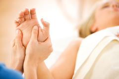 Massage: Therapist Works on Woman's Hands. Series of a young couple getting massages by therapists.  Together, as well as separate.  Bright and clean Royalty Free Stock Photos