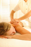Massage Therapy. Beautiful woman in a spa with massage therapy Stock Image