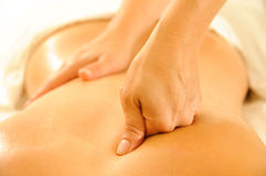 Massage Therapy. Beautiful woman in a spa with massage therapy stock images