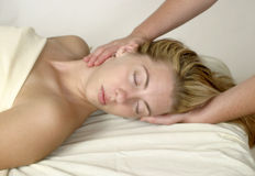 Massage Therapy. Female receiving massage therapy on neck Royalty Free Stock Images