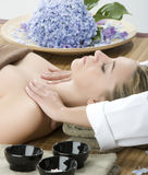 Massage therapy. Woman in a day spa getting a deep tissue massage therapy Royalty Free Stock Image