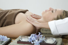 Massage therapy. Woman in a day spa getting a deep tissue massage therapy Stock Image