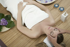 Massage therapy. Woman in a day spa getting a deep tissue massage therapy Stock Photography